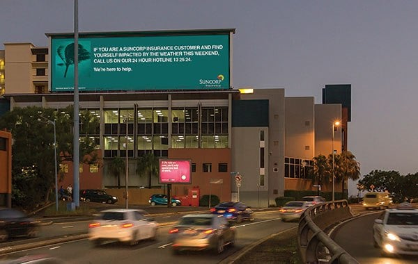 """Suncorp's """"We're here to Help"""" campaign run by oOh!'s network during Brisbane's cyclones."""
